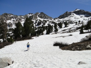 Traci hiking through the snow on the way to lake.