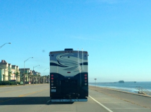 The MoHo driving down Galveston Beach