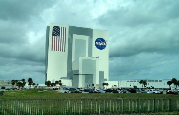 Vehicle Assembly Building - this is where they build 'em.  The stars on the flag are 6 feet across and the blue part of the flag the size of an NBA basketball court