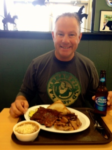 Happy with his Oklahoma Joe BBQ!