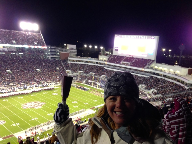 Traci getting in the spirit with the cowbell!  It was loud in there.