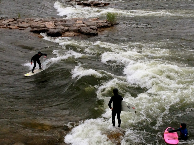 Brave souls surf on the Clark Fork River that runs through town